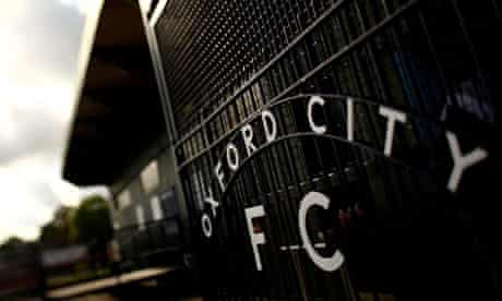 A view of the Oxford City FC gates inside Court Place Farm Stadium