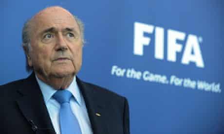 President of FIFA, Joseph Blatter, gives