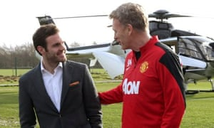 Juan Mata is met by David Moyes at Manchester United's training ground