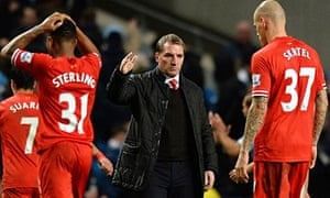 Brendan Rodgers consoles his players