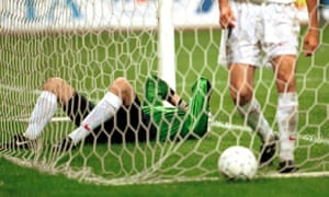 Russia's goalkeeper Alexander Filimonov lies in his goal after conceding to Ukraine