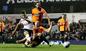 Érik Lamela gives Spurs the lead in the fourth round Capital One Cup tie against Brighton.
