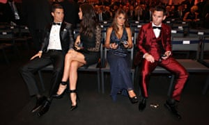 Cristiano Ronaldo and Lionel Messi, and partners, at the 2013 Ballon D'Or award.
