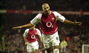 Thierry Henry celebrates scoring against Aston Villa in 2002