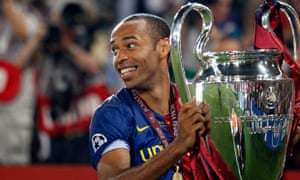 Thierry Henry holds the Champions League trophy