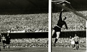 Uruguayan goalkeeper Roque Maspoli leaps to touch the ball over the bar.
