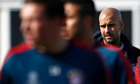 Bayern head coach Pep Guardiola attends a team training session in Munich