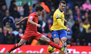 Philippe Coutinho stops a Jack Wilshere pass