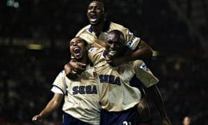 Ashley Cole, Patrick Vieira and Sol Campbell of Arsenal celebrate