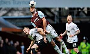 Andy Carroll climbs above Phil Jones