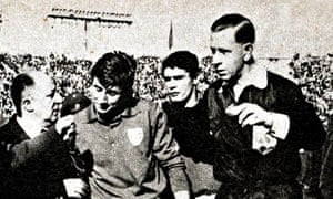 Ken Aston sends off Italy's Giorgio Ferrini, escorting him from the pitch, after he had retaliated by kicking Chile players.