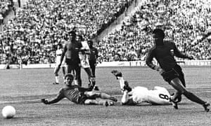 Italy's Fabio Capello (8) lies in a heap after a strong challenge from Haiti's Ernst Jean-Joseph (12).
