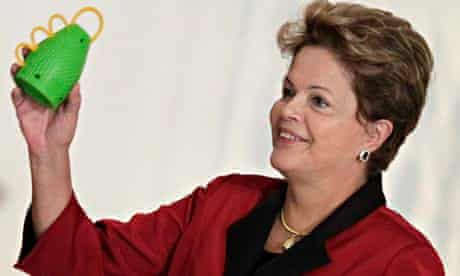 Brazil's president Dilma Rousseff prepares to lob a caxirola into the mix
