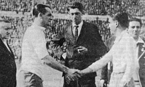 Uruguay's captain, José Nazassi, left, shakes hands with Argentina's 'Nolo' Fereyra in front of World Cup final referee John Langenus.