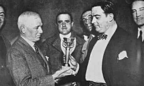 Jules Rimet presents the World Cup trophy to Dr Paul Jude, the president of the Uruguayan FA after the final.