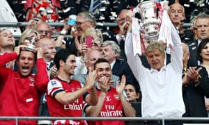 Arsenal manager Arsene Wenger lifts the FA Cup