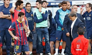 Gerardo Tata Martino, right, stands on the pitch after Barcelona lost their league crown