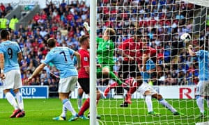 Cardiff City's Fraizer Campbell heads home to score against Manchester City