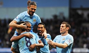 Manchester City celebrate during their 6-3 win over Arsenal