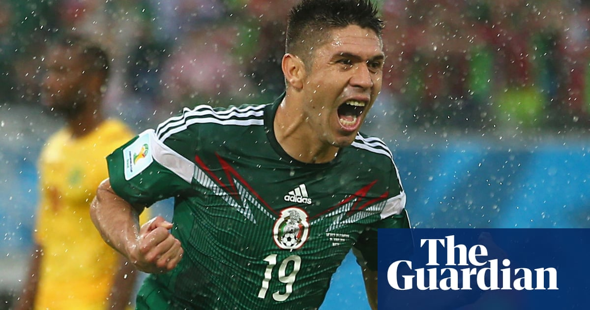 87737f765 Mexico s Peralta finally sees off Cameroon after referee fluffs his lines