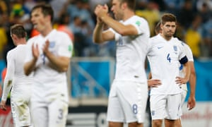 Steven Gerrard and dejected England team-mates after the defeat to Uruguay