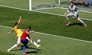 Chile's Alexis Sanchez scores against Brazil