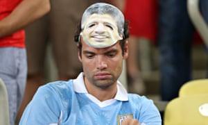 Dejected Uruguay fan with Suarez mask