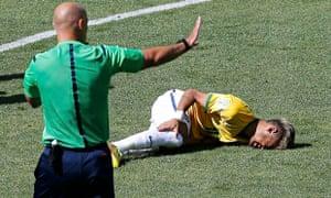 Brazil's Neymar lies injured on the ground against Chile