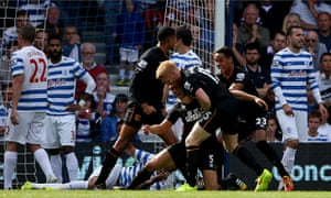 Hull City's James Chester,grounded, is congratulated after scoring in the Premier League against QPR