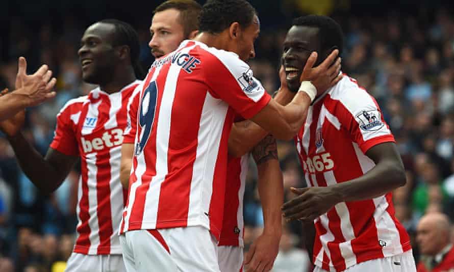 Stoke City's Mame Biram Diouf, right, celebrates scoring against Manchester City
