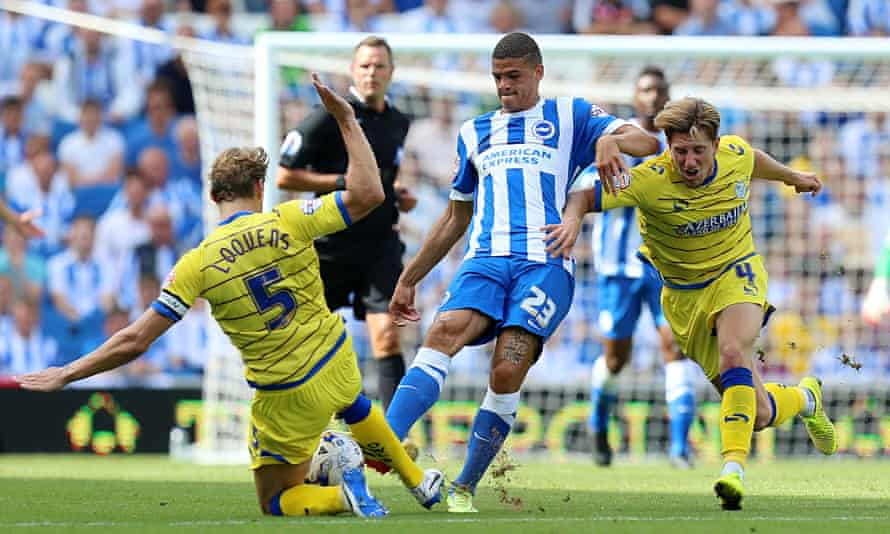 Brighton's Shamir Fenelon is tackled by Sheffield Wednesday's Glenn Loovens, left, at the Amex