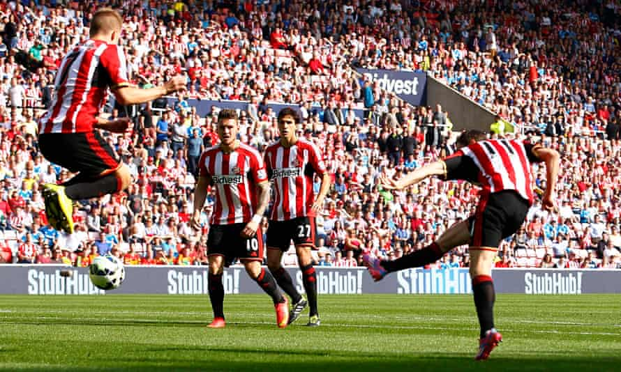 Sunderland's Adam Johnson, right, scores their first goal against Spurs in the Premier League