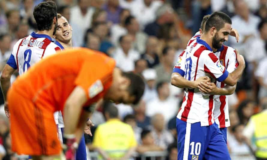 Arda Turan, right, celebrates after his winner in the Madrid derbyink