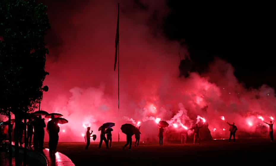 Albanian fans celebrate in the streets of Tirana on Sunday after their team qualifed for Euro 2016.