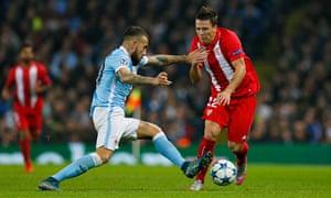 Nicolas Otamendi of Manchester City tackles Sevilla's Yevhen Konoplyanka.