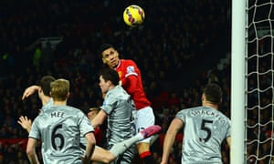 Manchester United's Chris Smalling rises to head home the first of his goals against Burnley.