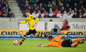 Borussia Dortmund's Marco Reus takes the ball around the Stuttgart goalkeeper Sven Ulreich to score