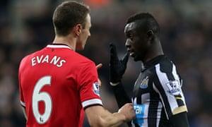 Manchester United's Jonny Evans clashes with Newcastle's Papiss Cissé