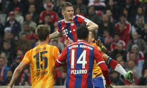 Bastian Schweinsteiger rises to score Bayern Munich's late winner against Hertha Berlin.