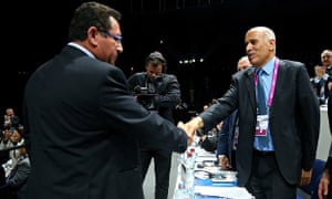 President of the Palestinian FA, Jibril Rajoub, right, shakes hands with Ofer Eini
