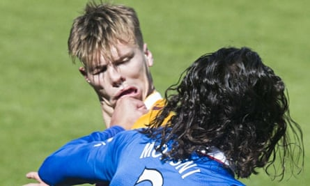 Rangers' Bilel Mohsni, front, clashes with Lee Erwin of Motherwell