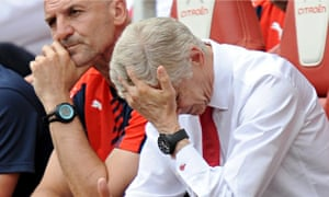 Arsenal's manager Arsène Wenger holds his head in exasperation during the defeat by West Ham.