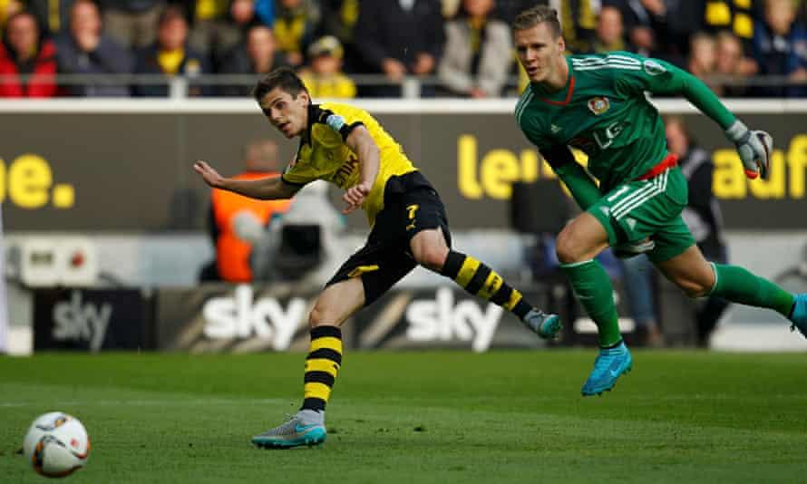 Jonas Hofmann, left, scores Borussia Dortmund's opening goal in the 3-0 win over Bayer Leverkusen.
