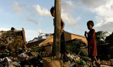 Poor children in Madagascar forced to scavange on rubbish tip