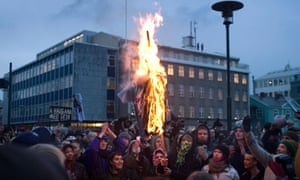 Icelandic protesters burn an effigy of their PM