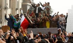 Egypt demonstrators celebrate army tank Tahrir square