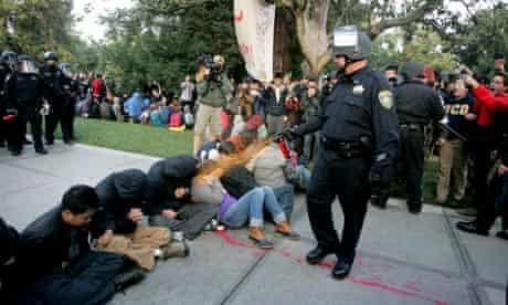 police officer pepper-sprays students