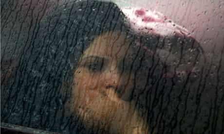 woman car rain