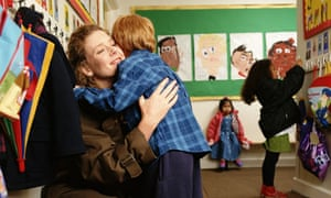 mother child hugging primary school