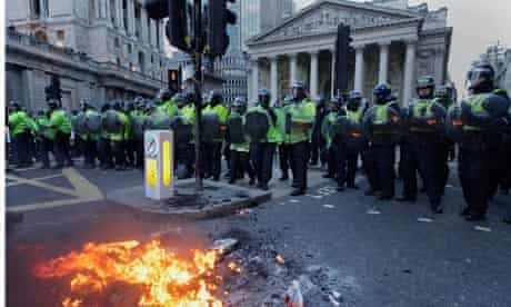 riot police bonfire protests